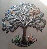 Metal tree of life with sun and moon