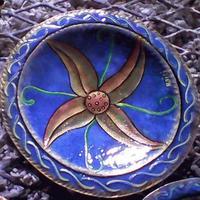 Metal plate with starfish